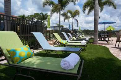 Poolside Loungers | Soak in the sun from our beautiful sundeck in one of the loungers.