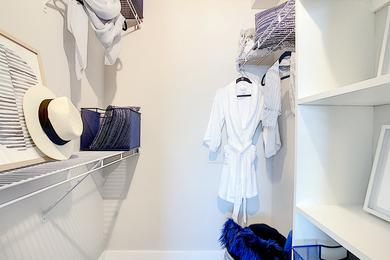Walk-In Closet | You'll love our spacious walk-in closets featuring built-in organizers.