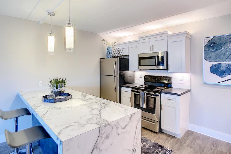 Newly Renovated Kitchens | Newly renovated kitchens featuring marble-style counter tops, and stainless steel appliances.