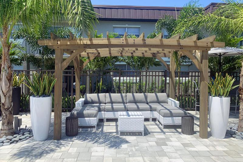 Poolside Pergola | Relax on our expansive sundeck under our poolside pergola.