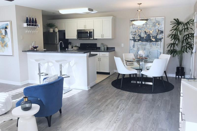 Kitchen & Dining | We have a spacious open floor plan with a breakfast bar and a separate dining area featuring contemporary lighting.