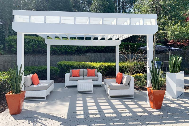 Poolside Pergola | Relax by the pool at our beautiful poolside pergola and seating.