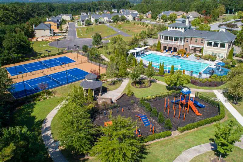 Outdoor Amenities | At West Eleven, residents can enjoy an ample amount of outdoor amenities such as a playground, tennis courts, resort-style swimming pool, and an off-leash dog park.