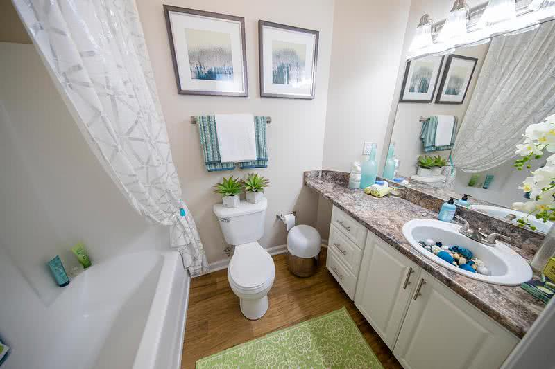 Updated Bathroom | Updated bathrooms featuring granite-style counter tops and large mirrors.