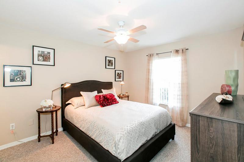 Bedroom | Spacious bedrooms featuring multi-speed ceiling fans and plush carpeting.