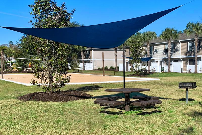 Picnic Area | Enjoy a picnic with friends and family in our shaded picnic area with charcoal grill.