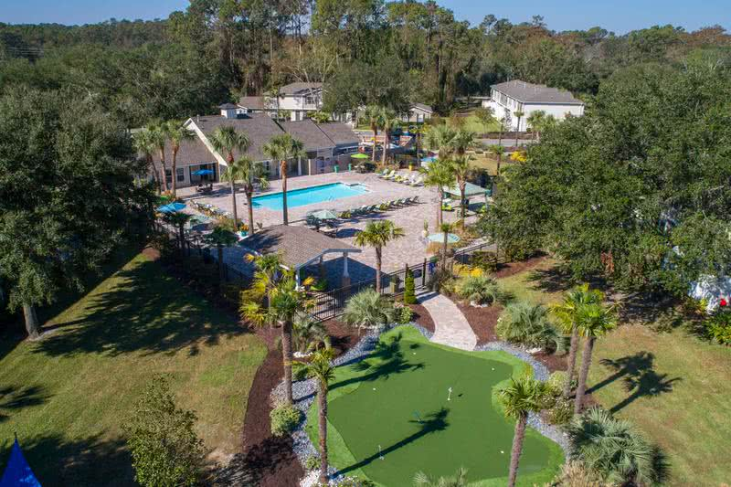 Outdoor Amenities | Lanier Landing features plenty of resort-style outdoor amenities including a pool and putting green.