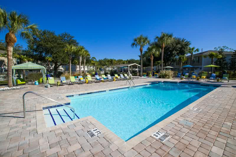Expansive Sundeck | Relax on our expansive sundeck on one of our many poolside loungers.