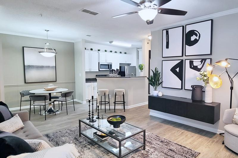 Open Floor Plans | Floor plans feature a spacious open layout, wood-style flooring or carpet with multi-speed ceiling fans.