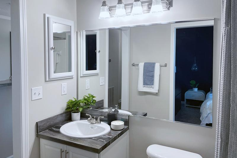 Guest Bathroom | Guest bathrooms feature tile flooring and black fusion countertops.