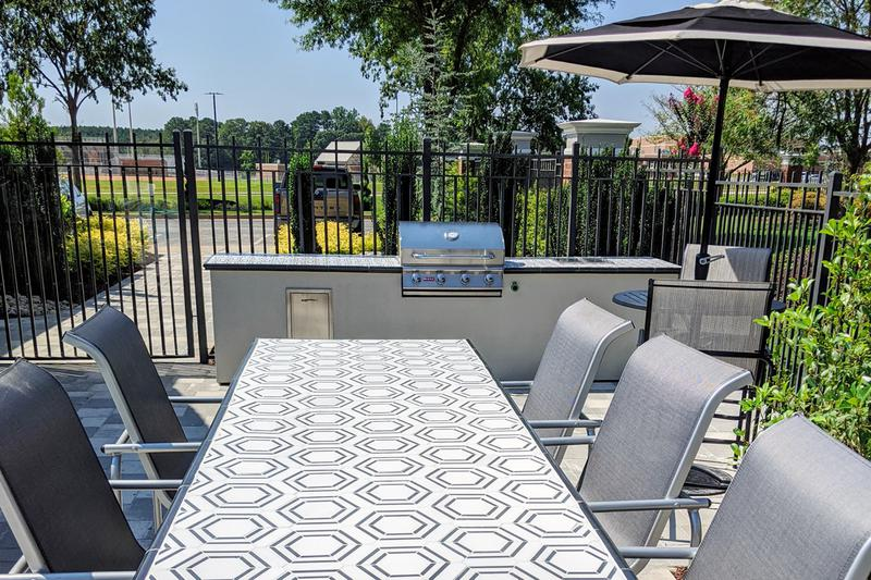 Outdoor Kitchen & Grilling Area | Have a cookout at our outdoor kitchen featuring a gas grill for residents use.