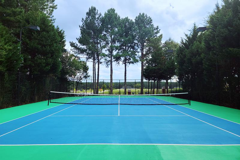 Newly Re-Surfaced Tennis Courts | Play a game at our full-sized, newly re-surfaced tennis court.