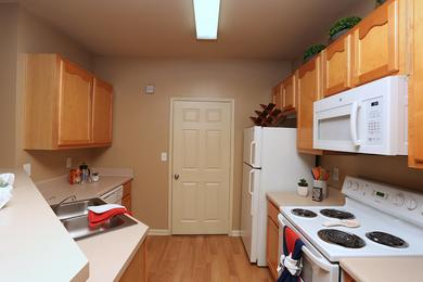 Kitchen | Kitchens featuring wood-style flooring, ample cabinetry and all the appliances you need!