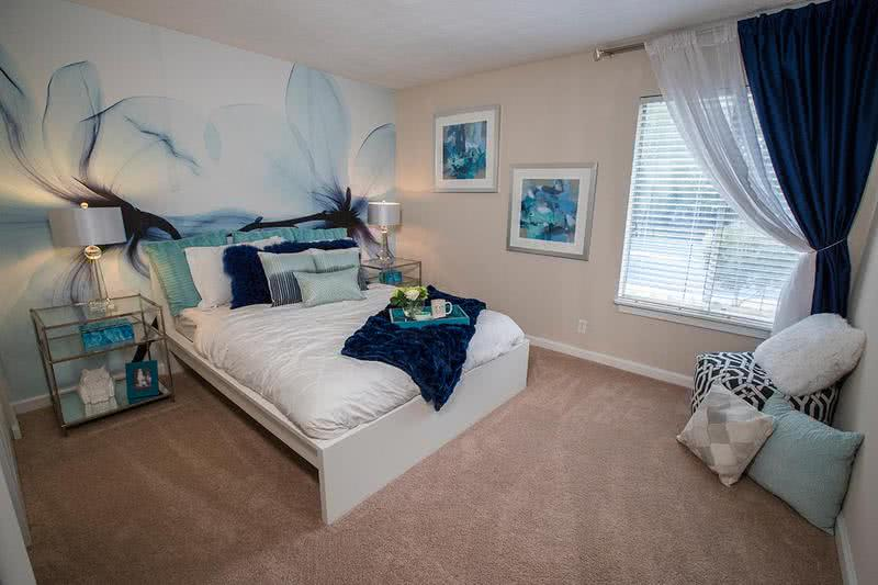 Bedroom | Spacious bedrooms featuring plush carpeting or wood-style flooring.