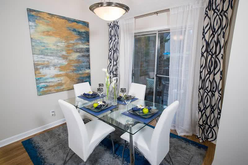 Dining Room | Separate dining areas that open up to the kitchen featuring contemporary lighting.