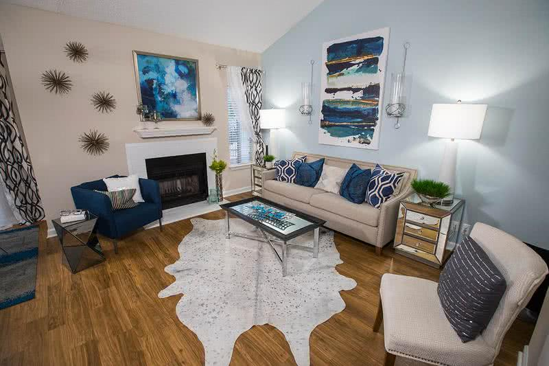 Living Room | Spacious living rooms with wood-style flooring. Enjoy wood-burning fireplaces in select apartment homes.