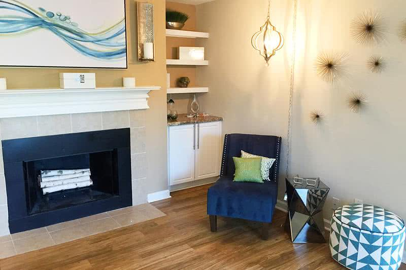 Fireplace | Your living room is complete with a fireplace and built-in shelving.