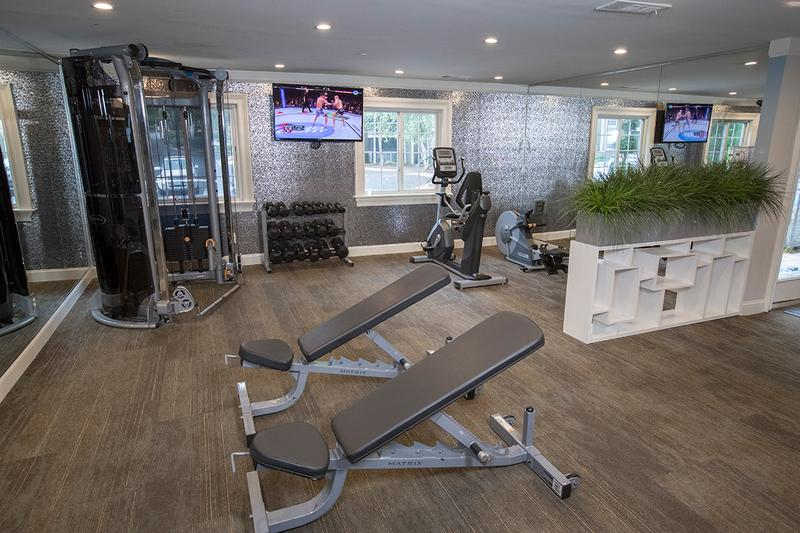 Fitness Center | Our fitness center features all of the weight training and cardio equipment you need for a full body workout.
