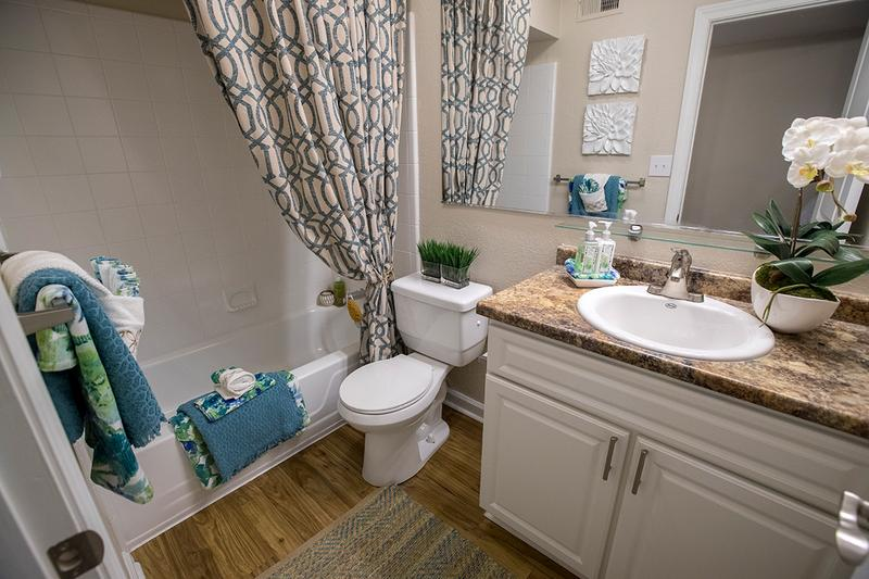 Bathroom | Bathrooms feature updated countertops and cabinetry and large mirrors.