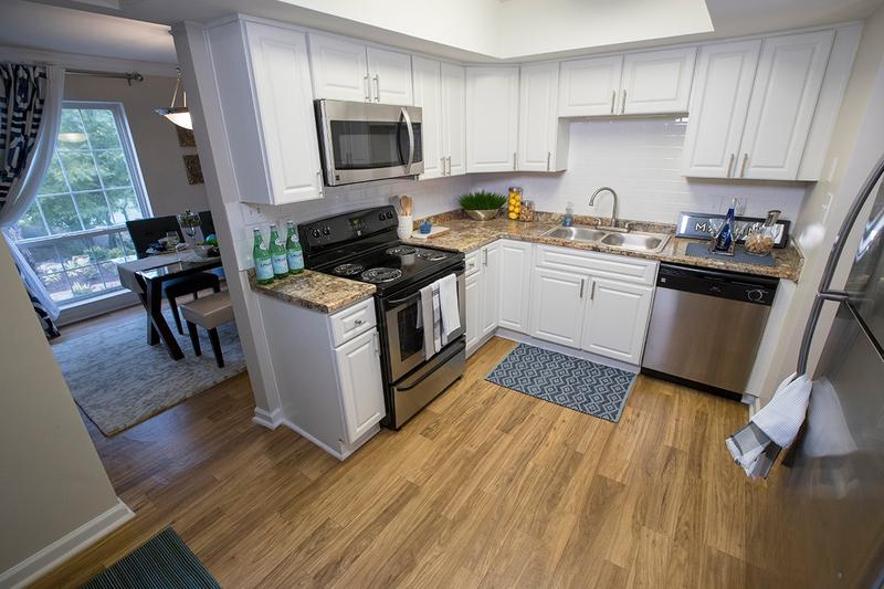Kitchen | Updated kitchens featuring updated counter tops, cabinets and flooring.