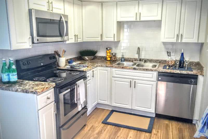 Kitchen | Newly remodeled kitchens featuring updated counter tops, cabinets and flooring.