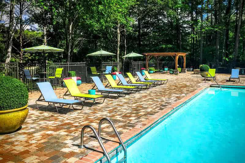 Expansive Sundeck | Lay out in our brand new expansive sundeck featuring poolside loungers and tables with umbrellas.