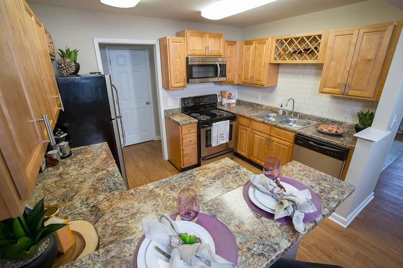 Kitchen with Breakfast Bar | Host your guests in a gorgeous chef inspired kitchen with updated cabinets and granite style countertops.