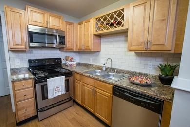 Stainless Steel Appliances | Kitchens featuring wood-style flooring, stainless steel appliances and plenty of cabinetry.