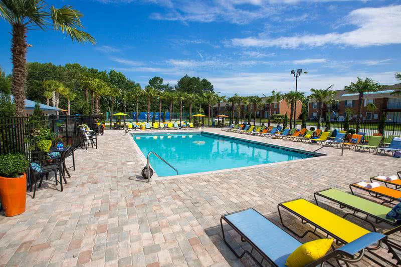 Pool with Expansive Sundeck | Unwind by our pool or lay out on our sundeck.