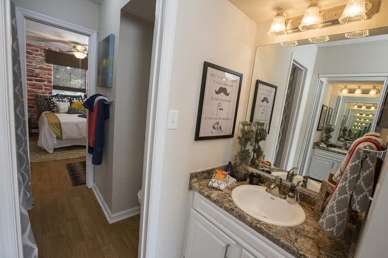 4x2 Bathroom | Newly updated bathrooms with large mirrors, updated lighting, granite-style counter tops and large mirrors.