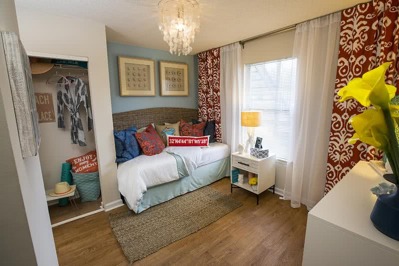 Bedroom | Spacious bedrooms featuring wood-style flooring and large windows.