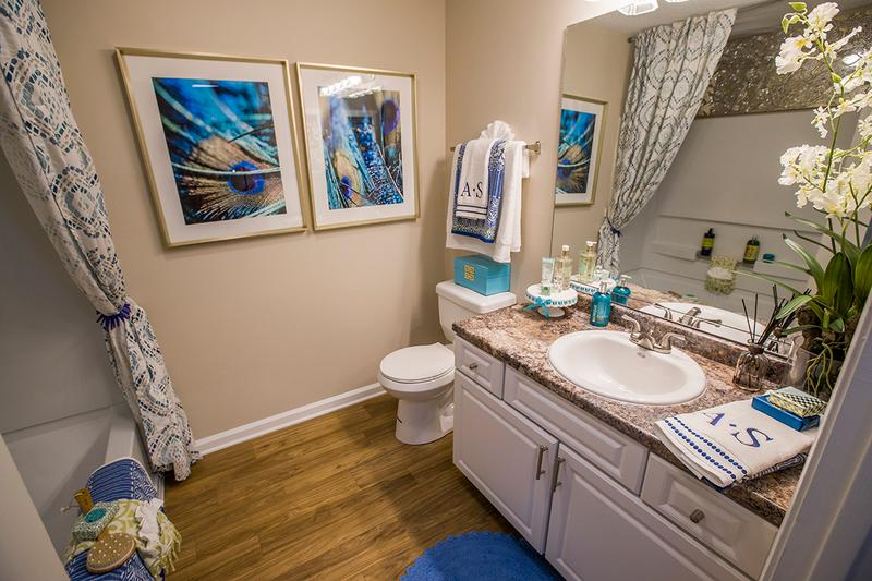 Granite-Style Bathroom | Our spacious bathrooms are fully renovated and feature large mirrors.