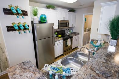 Granite-Style Kitchen | Our newly renovated kitchens feature stainless steel appliances.