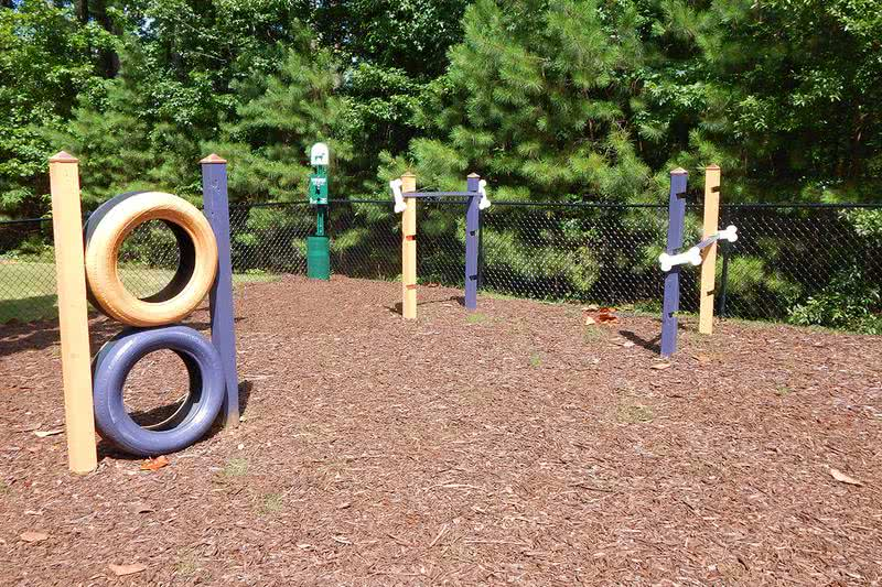 Dog Park with Agility Equipment | Your furry friend will love running around our brand new dog park, complete with agility equipment!