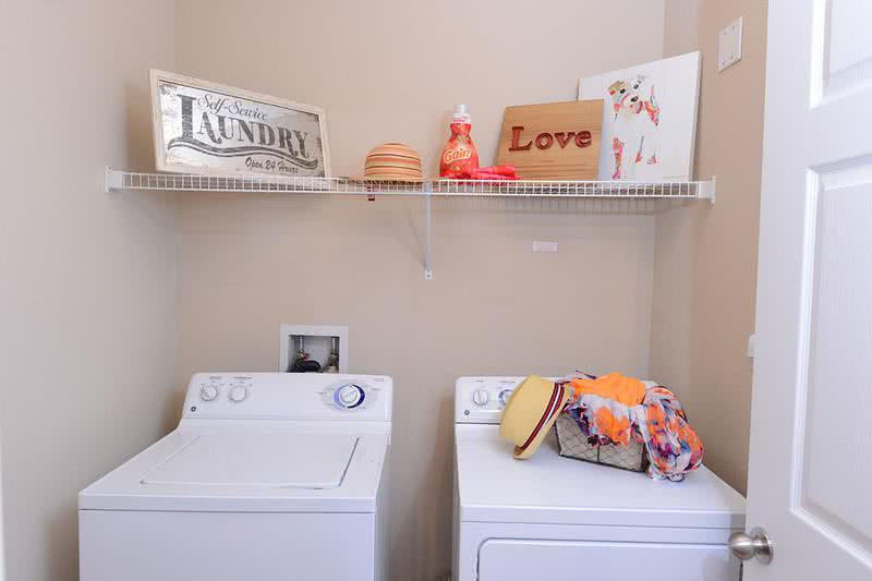 Washer & Dryer Included | Large laundry rooms boast washer and dryer sets in every apartment home.