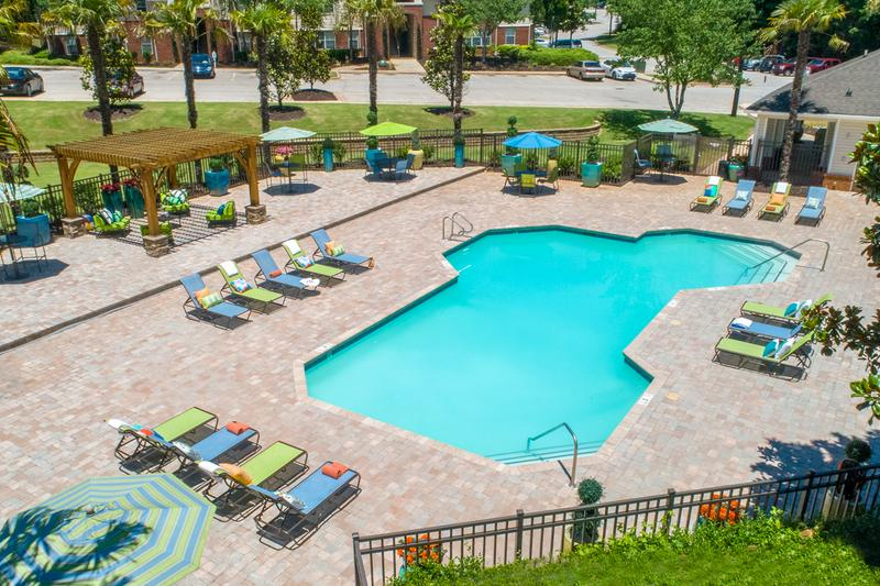 Resort-Style Swimming Pool | Our pool deck offers brand new furniture and large open pool deck for our residents to enjoy.