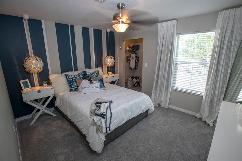 Bedroom | Each room includes a ceiling fan, large closet and tons of natural lighting.