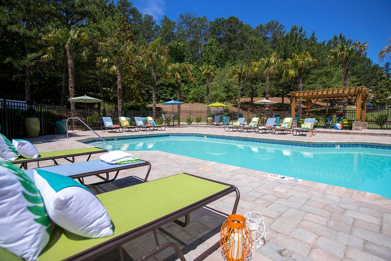 Poolside Loungers | Relax on one of our poolside loungers and soak in the sun.