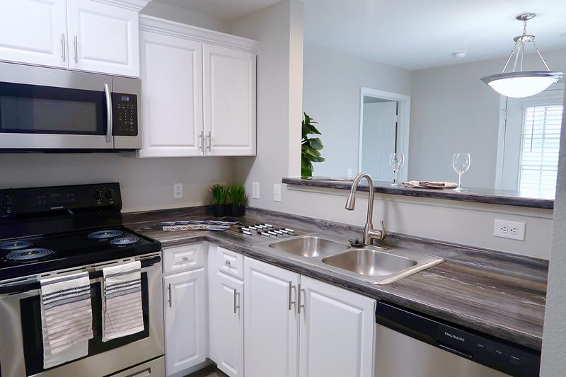 Renovated Kitchens | Our newly renovated kitchens feature wood-style flooring, black-fusion countertops and stainless steel appliances. We are excited to offer in-person tours while following social distancing and we encourage all visitors to wear a face covering.