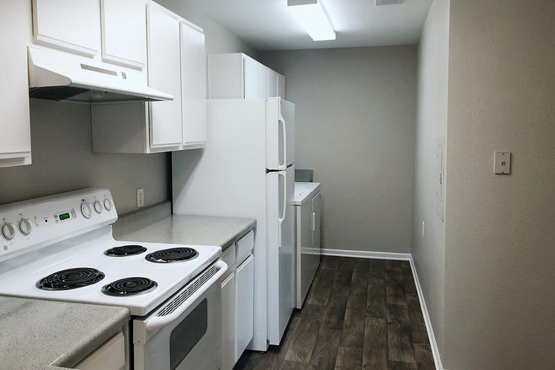 Kitchen and Laundry | Kitchens also feature full size washer and dryer appliances.