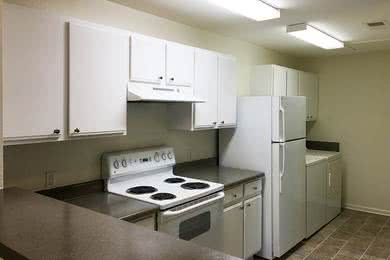 Kitchen & Laundry | Kitchens also feature full size washer and dryer appliances for your convenience.