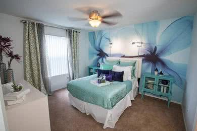 Bedroom | Spacious bedrooms featuring plush carpeting and ceiling fans.
