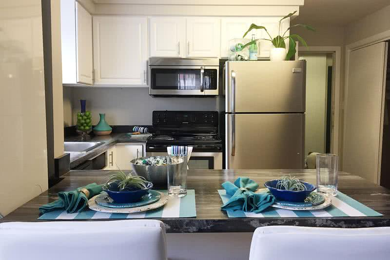 Stainless Steel Appliances | Updated kitchens featuring stainless steel appliances and a breakfast bar.