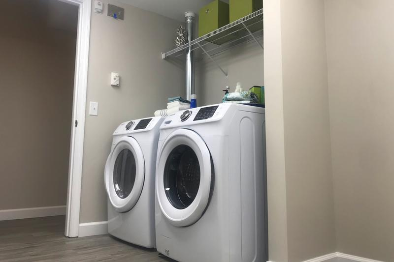 4x4 Laundry Room | The laundry room is equipped with a brand new washer and dryer, and also offers plenty of additional storage space.