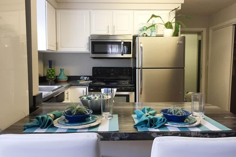 2x1 Remodeled Kitchen | Our 2 Bedroom apartments feature upgraded kitchens with stainless steel appliances, wood-style flooring, and granite-style counter tops.