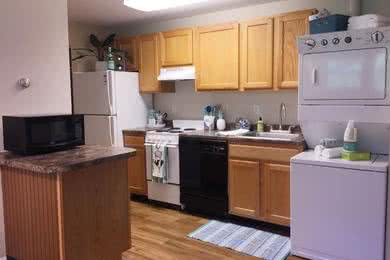 Open Kitchens with Breakfast Bar | Our 1 and 2 bedroom open kitchens with a convenient  breakfast bar and microwave.