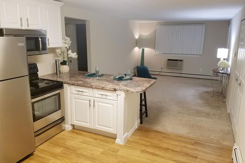 Newly Remodeled Homes | You will enjoy our newly remodeled apartment homes featuring wood-style flooring, granite-style countertops, and stainless steel appliances.