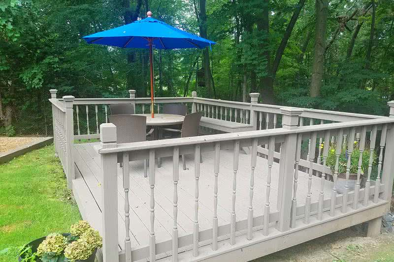 Deck | Enjoy a scenic view of the woods and watch the kids play on the playground from our deck.