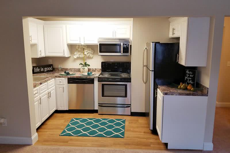 First Floor 1 Bedroom Kitchen | Newly renovated kitchens featuring wood-style flooring, granite-style counters and stainless steel appliances.
