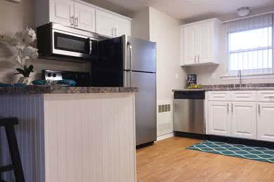 2 Bedroom Updated Kitchen | Fully applianced kitchen with dishwasher & open style floor plan.